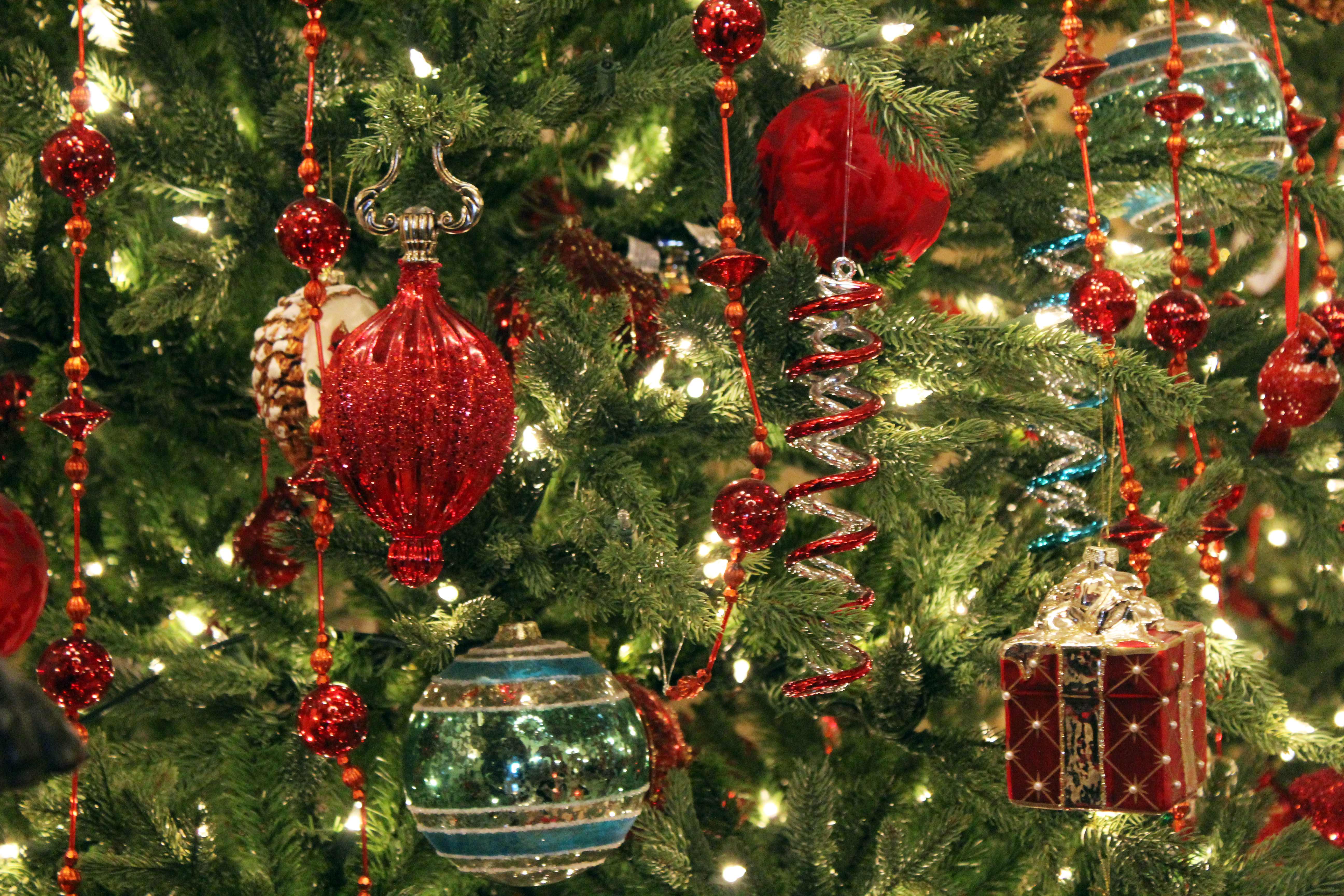 The Breakers - Newport RI | Festive glass ornaments and other baubles adorn one of thirty magnificent Christmas trees during the holidays at The Breakers mansion.