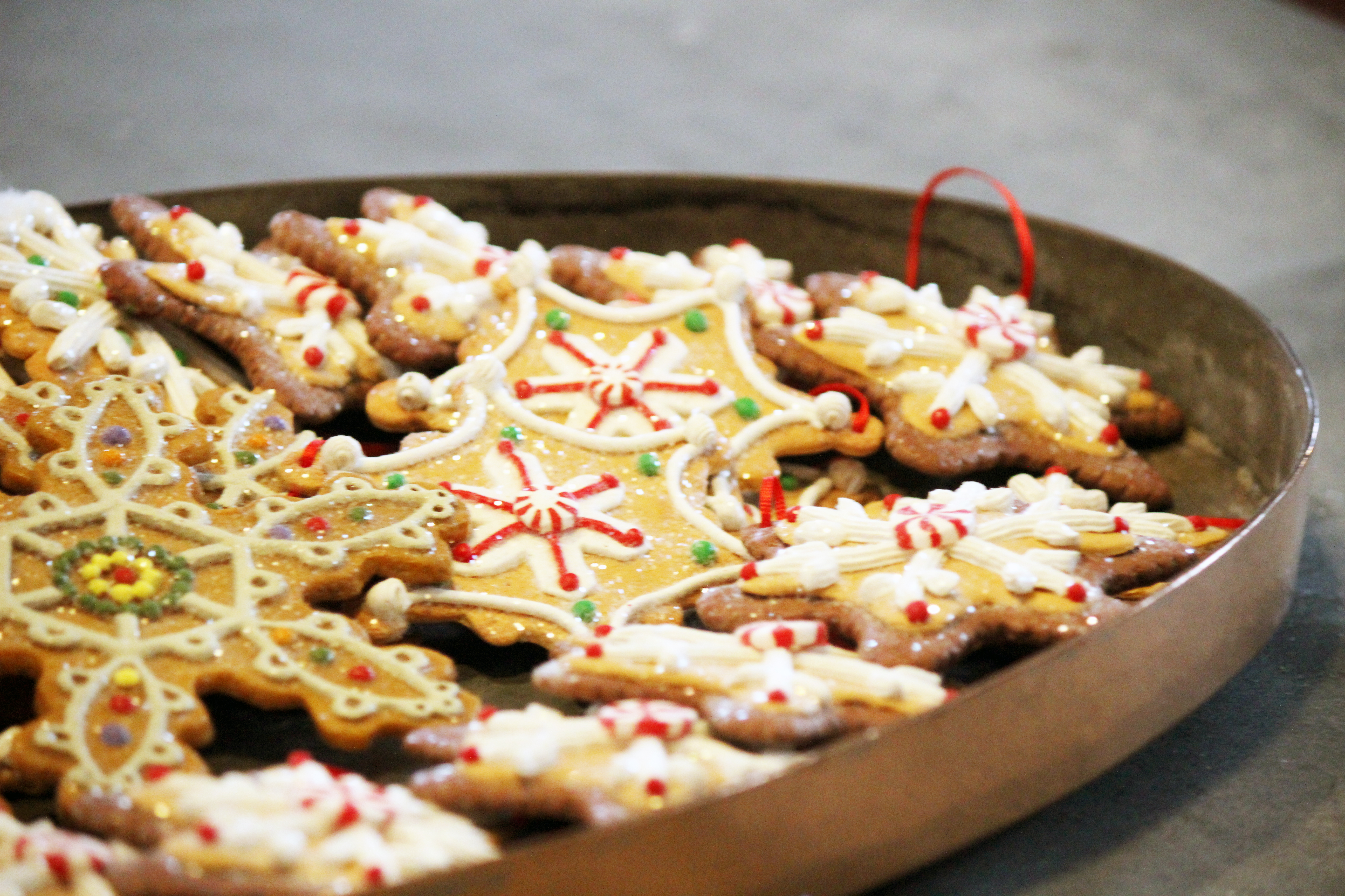 The Breakers - Newport RI | A tray of expertly decorated sugar cookies are strewn with red ribbon by the Pastry Chef and ready to be hung on a Christmas tree. I bet they're delicious!