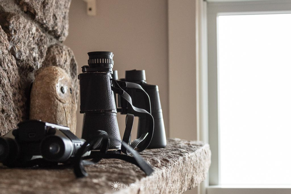 Binoculars on a mantel for birdwatching - Atlantic ocean view