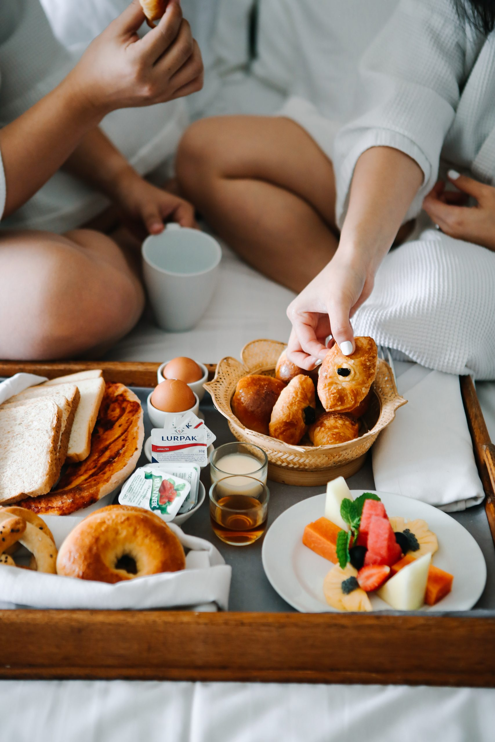 couple eating breakfast in bed - hotel specials