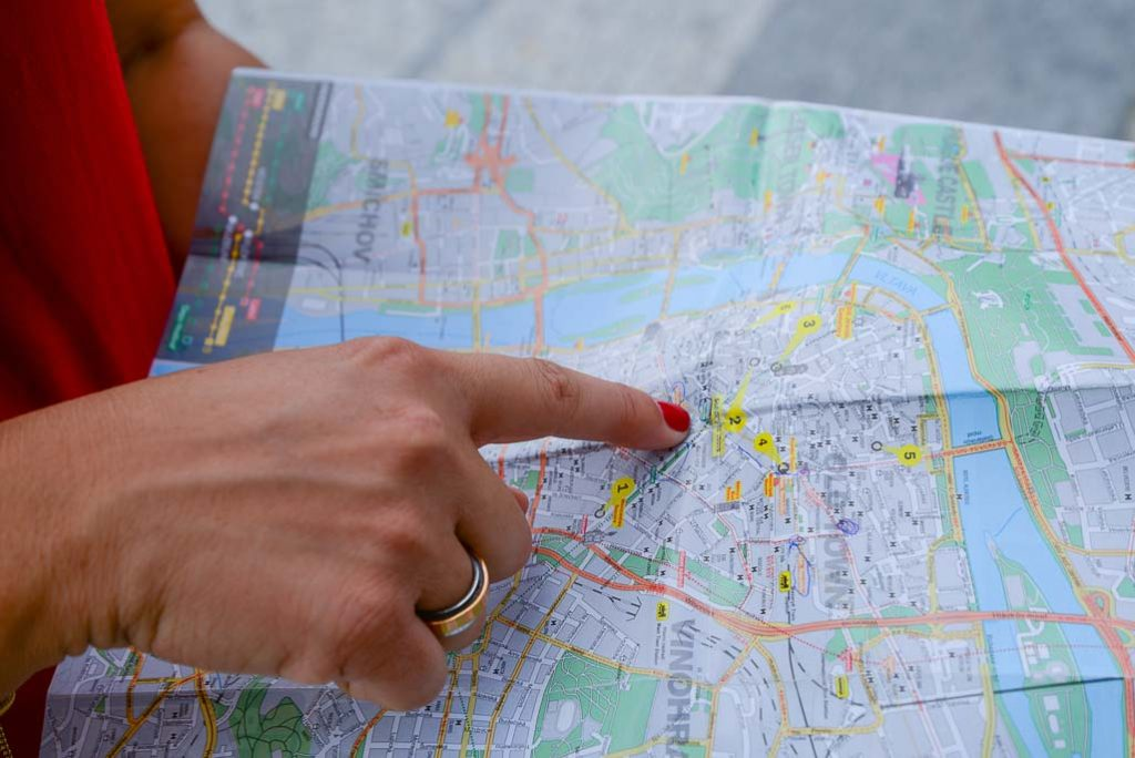 Woman points to a location on map