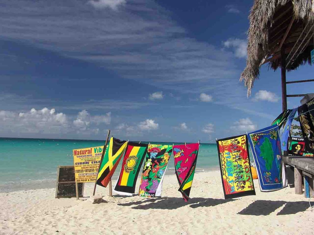 Colorful towels hang to dry on the beach in Jamaica (Caribbean long stay vacations)