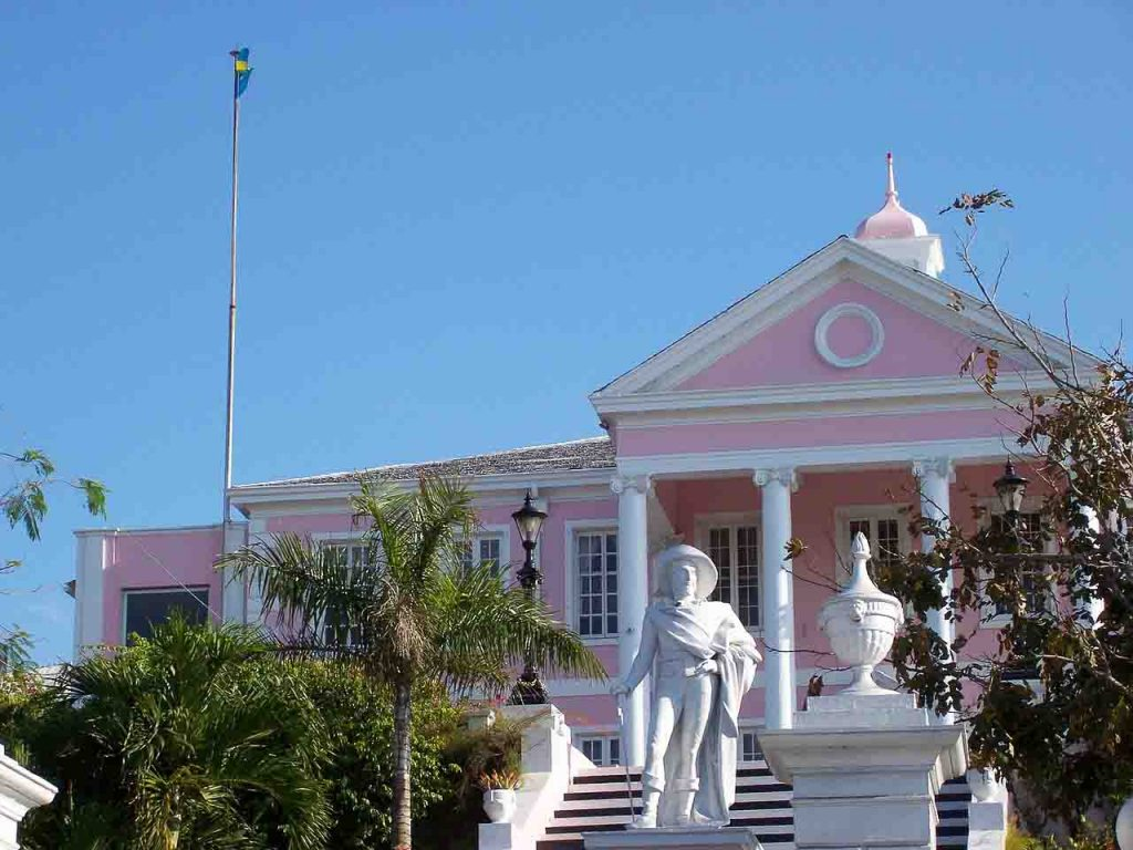Pink building with white statues in Nassau, a great winter getaway