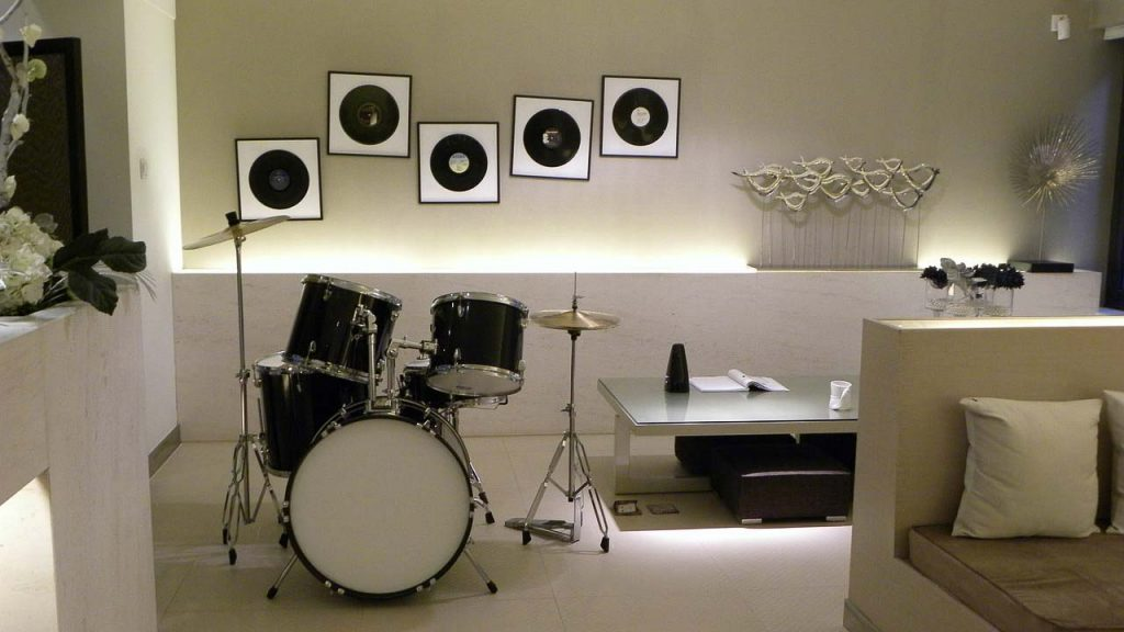 Hobby or Music Room with drum set, vinyl records as one of several basement conversion ideas.