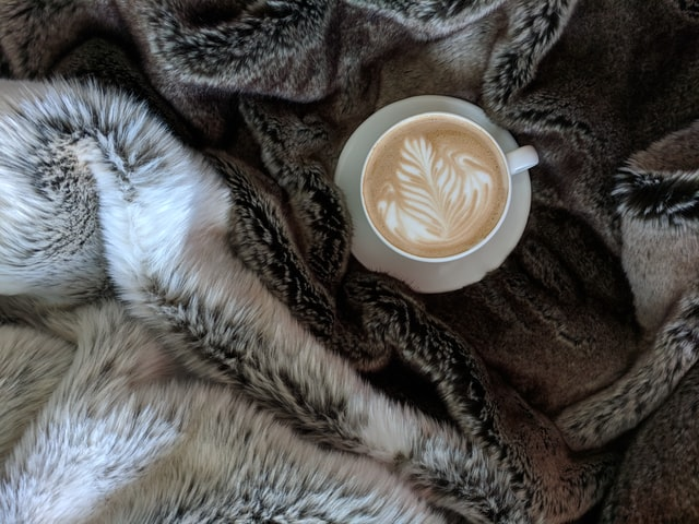 Checklist for Winterizing Your Home: Add faux fur throws to make your space cozier (Shown: fur blankets and cappuccino)