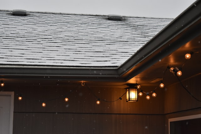 Checklist for Winterizing Your Home: Scan the roof for defects (Shown: snow-covered roof)