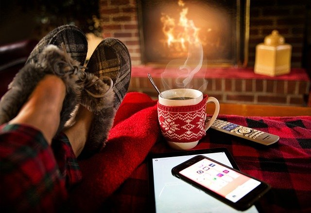 Fireside scene with cozy slippers and tea