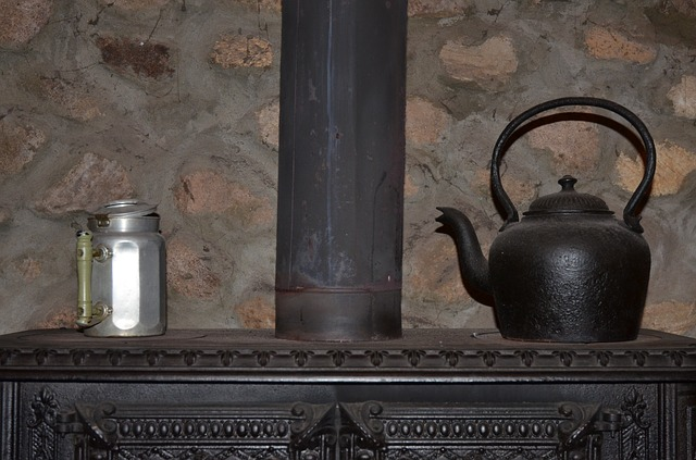 Checklist for Winterizing Your Home: Assess your home heating and schedule service (Shown: wood burning stove with kettle)
