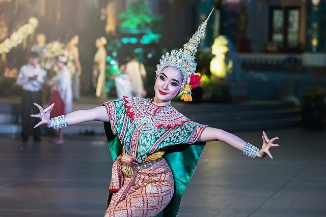 woman posting in traditional thailand garb