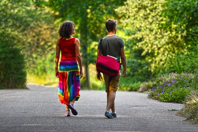 couple walking - a sustainable eco-friendly travel experience