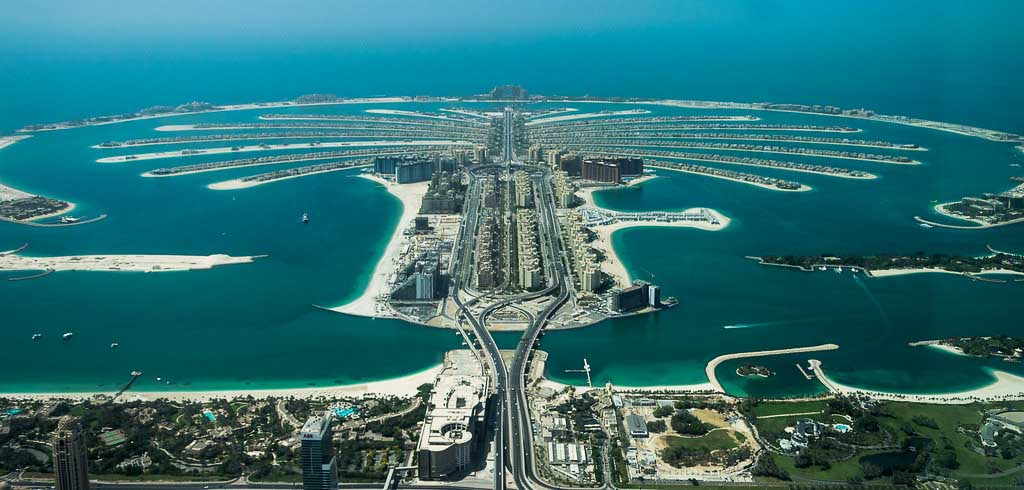 Aerial view of Palm Jumeirah, man made islands in a palm-tree design in the Persian Gulf