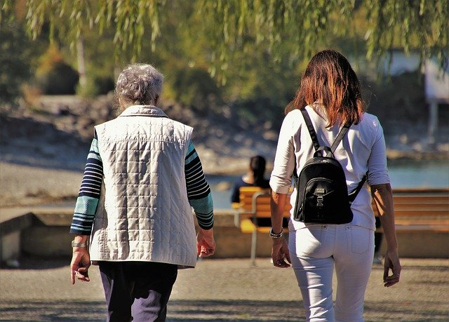Older and younger women walking.