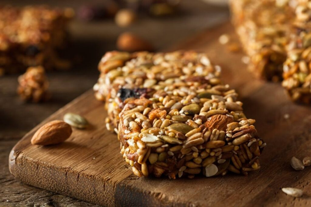 Include some natural protein bars to your food trip food list