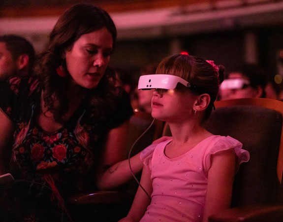 Little girl enjoys a concert using her eSight Eyewear