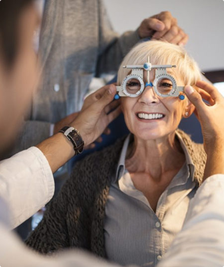 Low vision patient receives eye exam to see if she could be a candidate for eSight's electronic eyewear