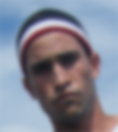 A blurry face of a man. A representation of what someone with optic nerve hypoplasia might see.