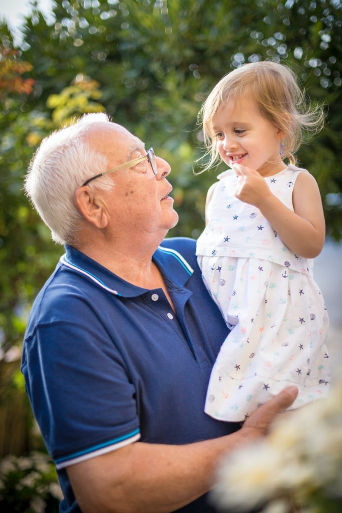 Grandfather with granddaughter; Retinitis Pigmentosa is a genetic condition