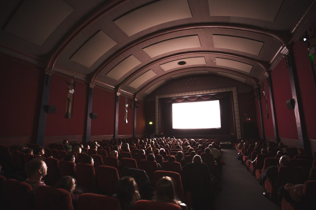 Movie theater, may be difficult for those with RP to see