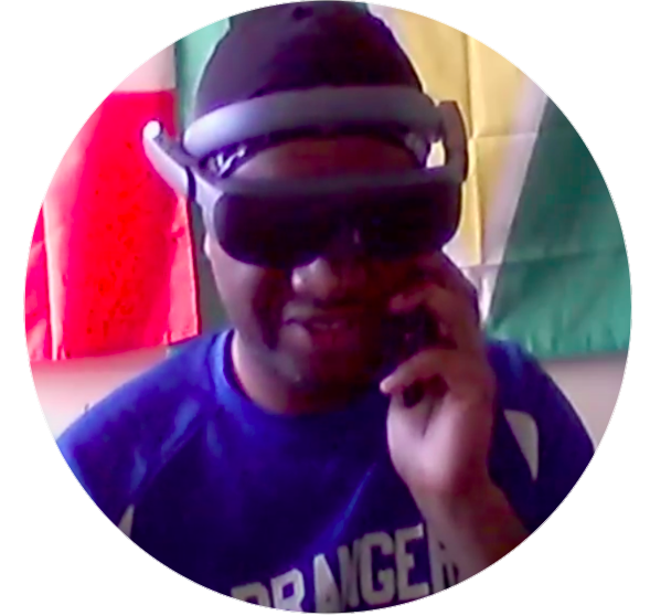 Jason seen wearing esight's high technology low vision aid while talking on the phone