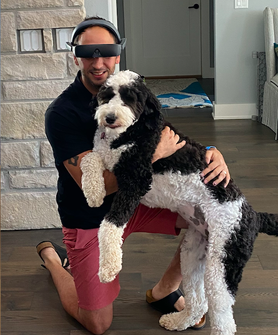 Christopher wearing eSight with his dog