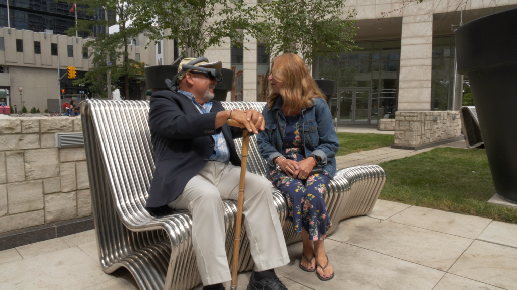 Gary Foster, sitting with his wife. Gary is a long term eSight user and macular degeneration patient.