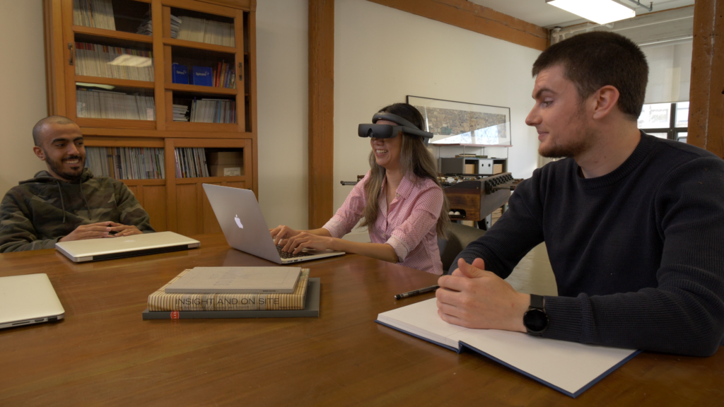 student with low vision using eSight during a group project