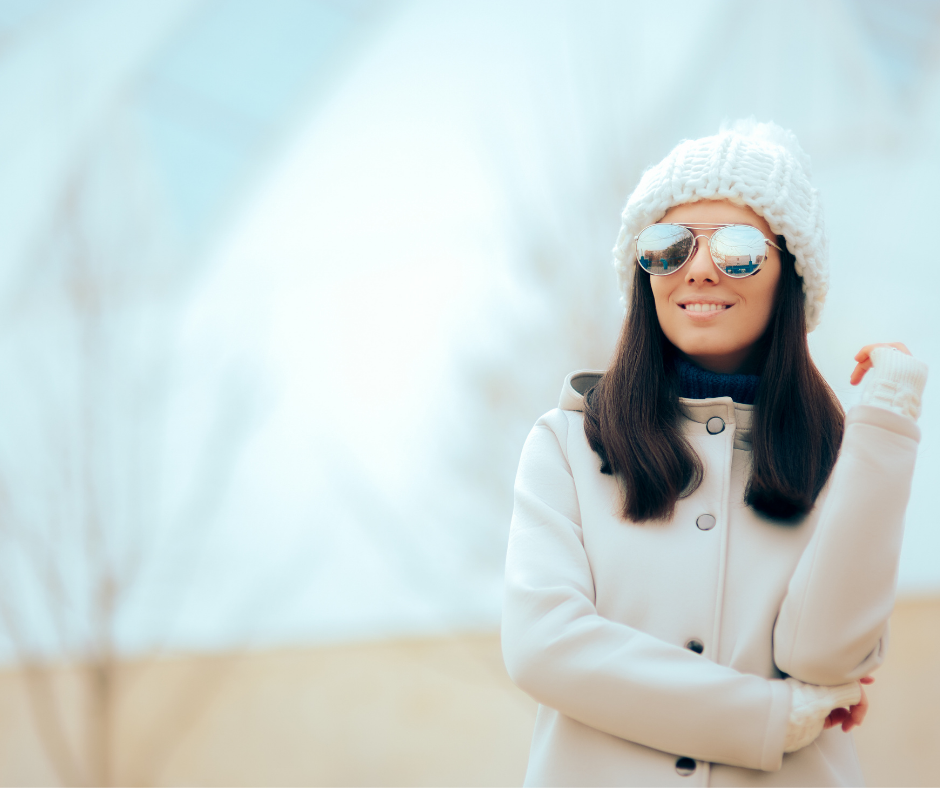 woman wearing sunglasses outside in winter