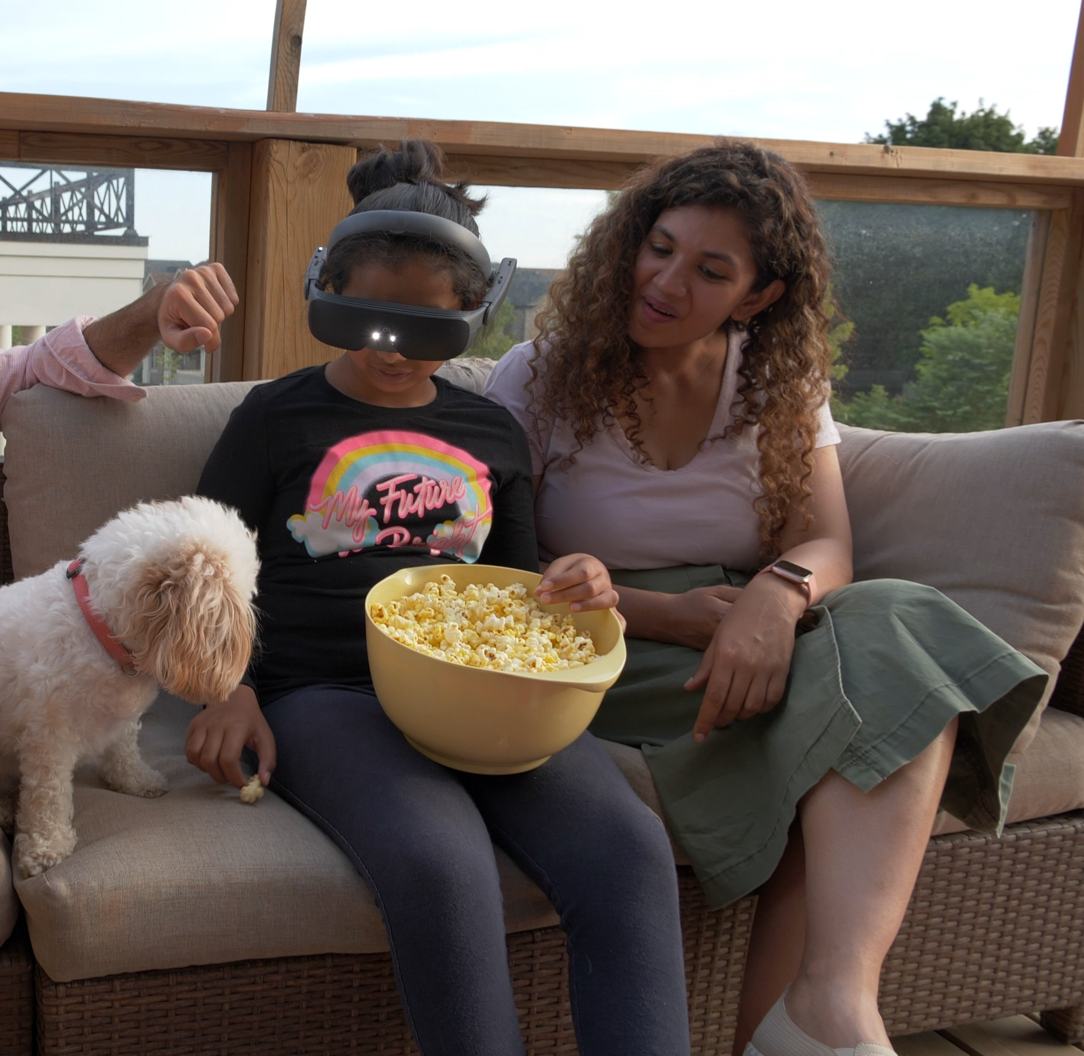 Zara and her family watching a movie