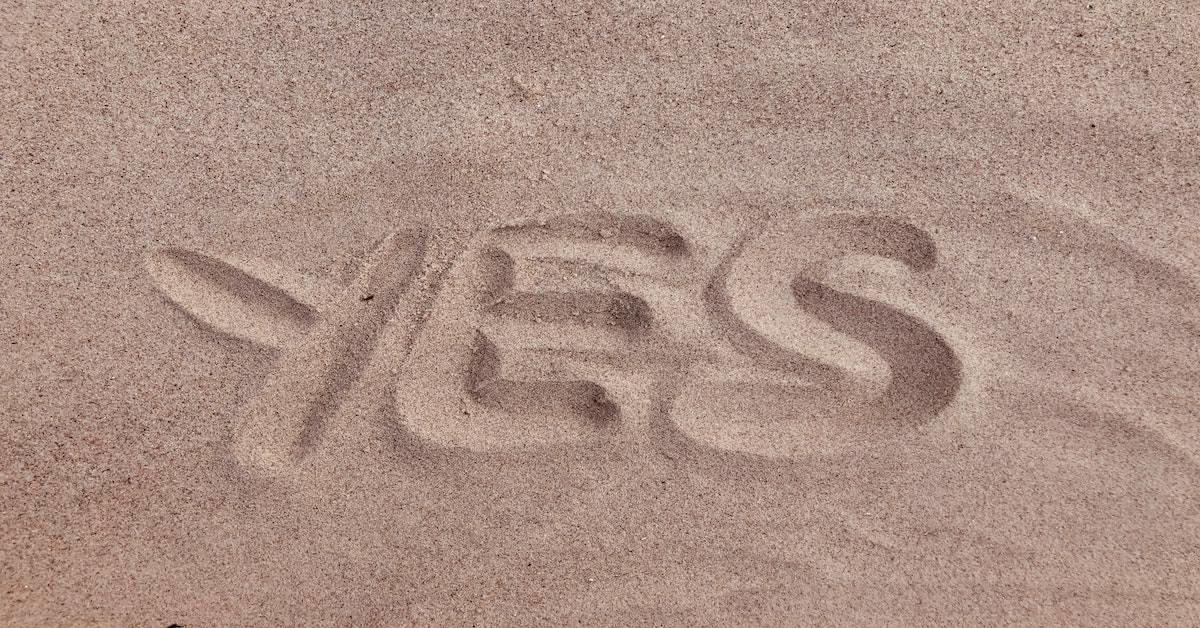 """yes"" written the sand"