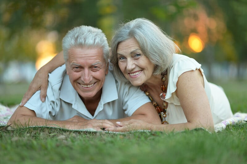 Smiling couple after dental treatment