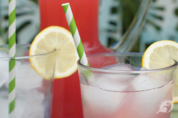 Gluten-Free Food: Raspberry Green Tea Lemonade in a chilled glass with Lemon on the rim