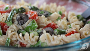 Asparagus and Pea Macaroni Salad on a bowl