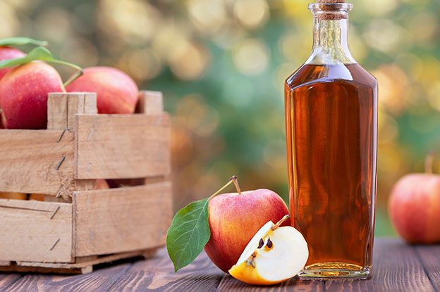 Gluten-Free Food: Apple Cider Vinegar Bottle with Apples