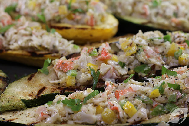 Close-up of Crab-Stuffed Zucchini and Summer Squash Boats fresh from the grill on a tray.