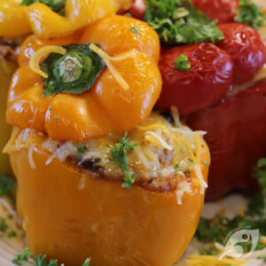 Mexican Stuffed Peppers on a plate with cheese