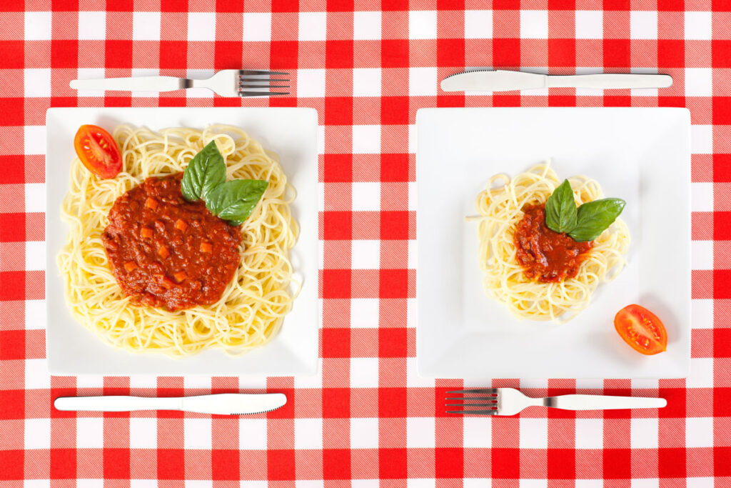 one portion of spaghetti with sauce vs. a big serving size of spaghetti and sauce