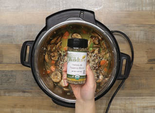 Mirepox (Onions, Carrots and Celery), mushrooms and garlic Chicken broth and Herbes de Provence in an Instant Pot