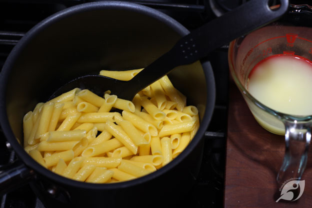 Step 3 - Add the penne pasta to the boiling water and cook according to the instructions: drain, and reserve about ½ cup of the pasta cooking water.