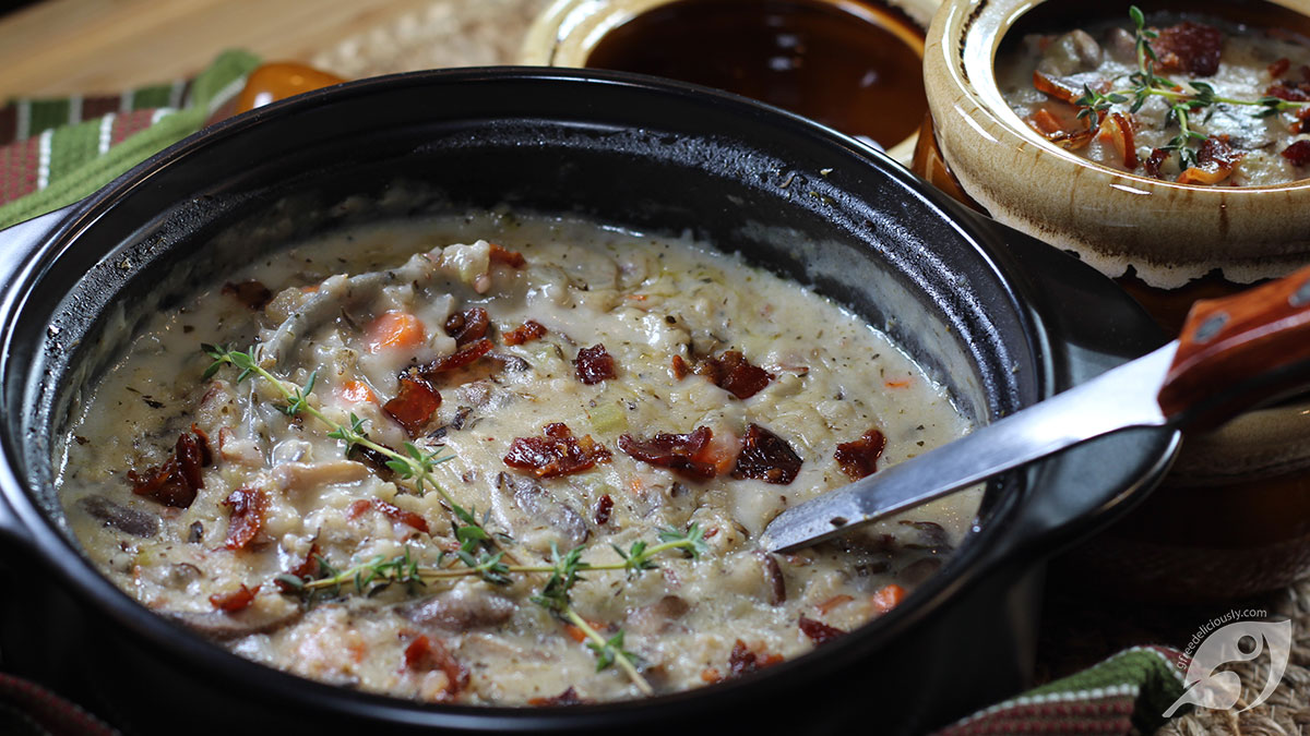 Pot of Creamy Wild Rice & Mushroom Soup with filled bowl in the background