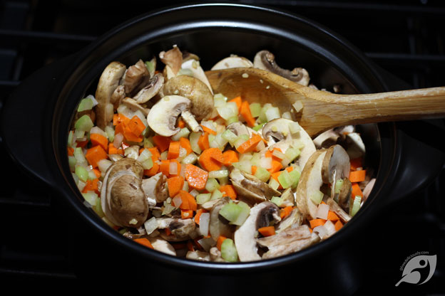 onions, celery, carrots, mushrooms in a dutch oven