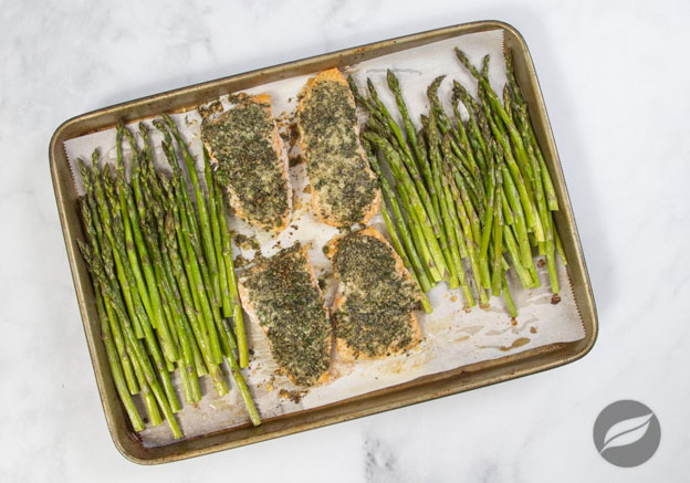 Garlic Parmesan Crusted Salmon on parchment on a sheetpan