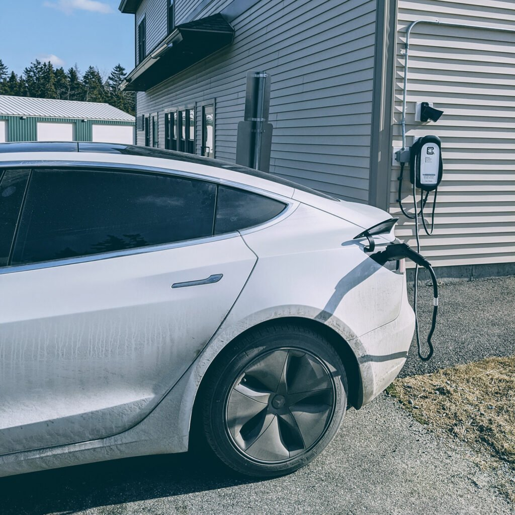 Tesla Model 3 Charging at a free charging station in Tremont, ME
