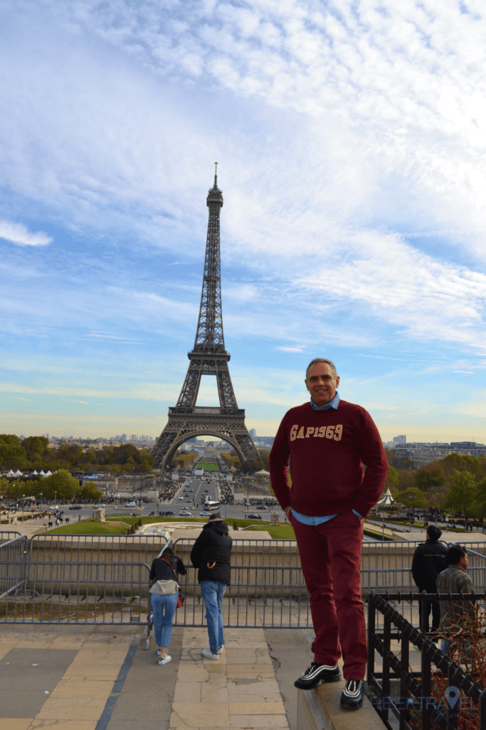 Family trip to Paris with kids. Visit to the Eiffel Tower