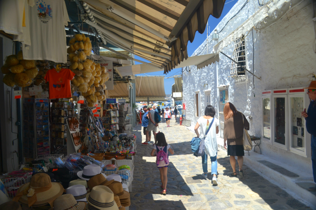 Family holidays in Hydra with  kids. Shopping in the traditional shops with souvenirs