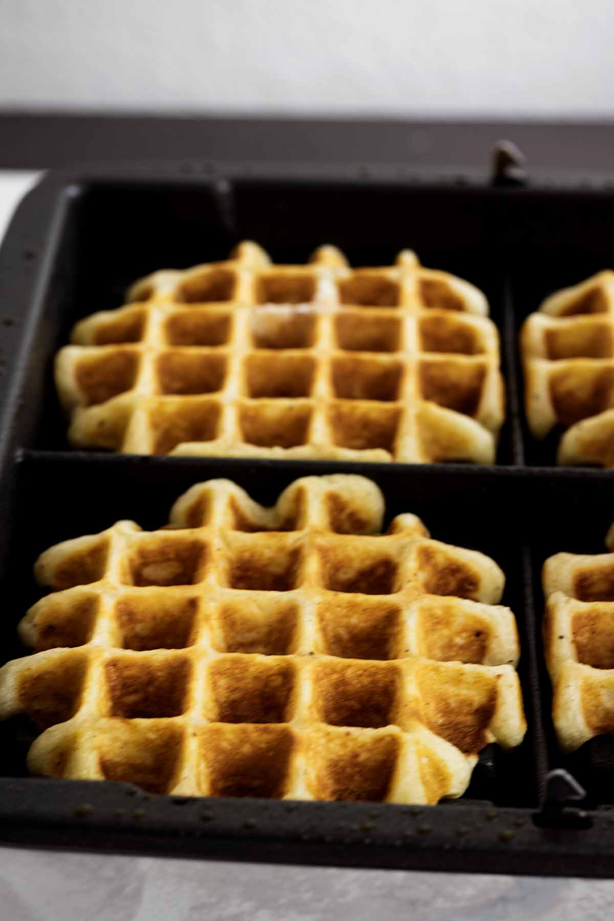 Waffles cooking on a waffle maker