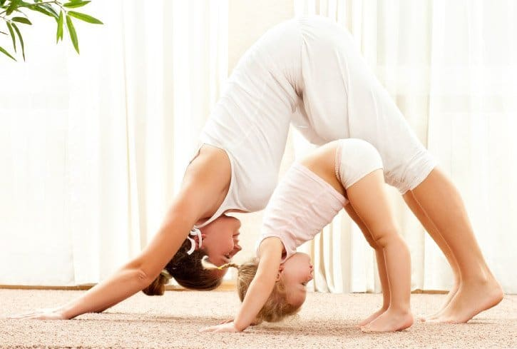 Teacher and toddler practicing Yoga