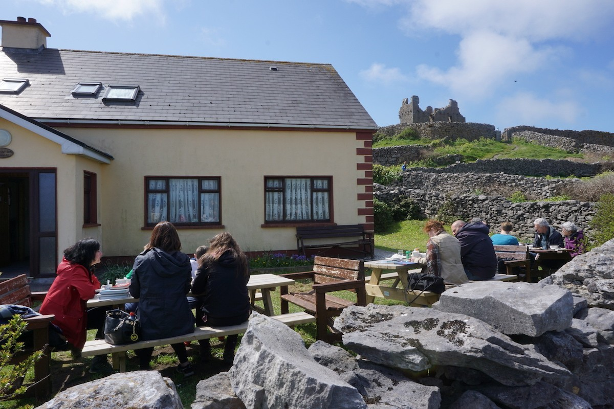 Small cafe, castle in backround on Inis Oirr