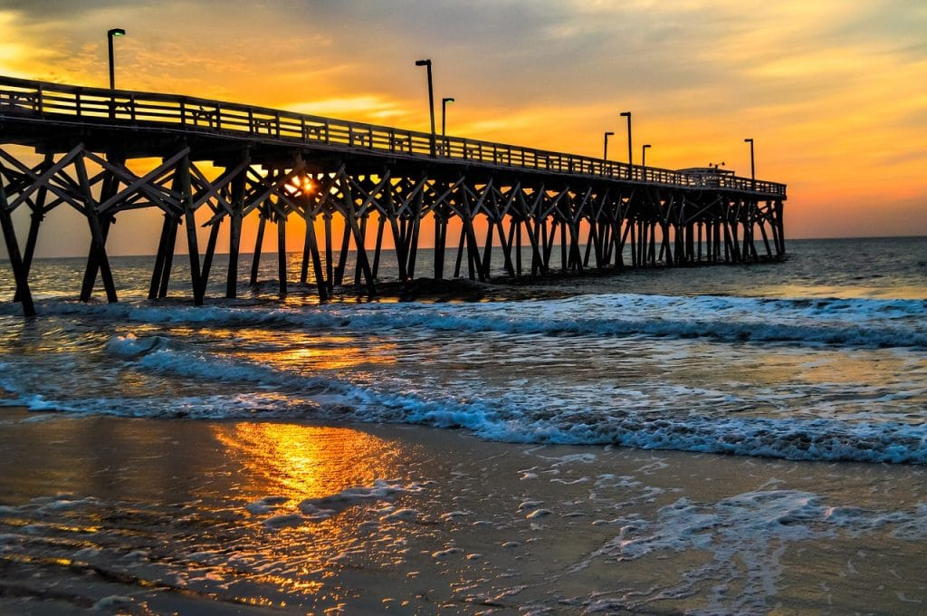a beautiful sunset over the myrtle beach shoreline