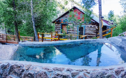 historic renovated cabin with natural hot tub from springs