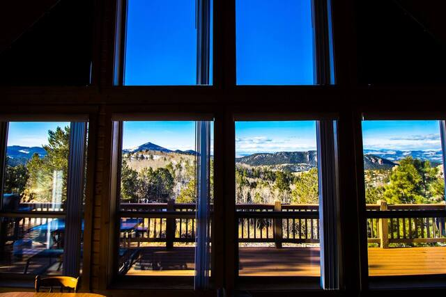 view of the mountains from the living room of a large secluded cabin in Colorado